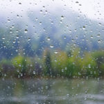 River view through window in rainy day. Rainy day. Rain drops. Rain drops background.